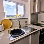 Kitchen with dishwasher, full oven/hops and stunning view